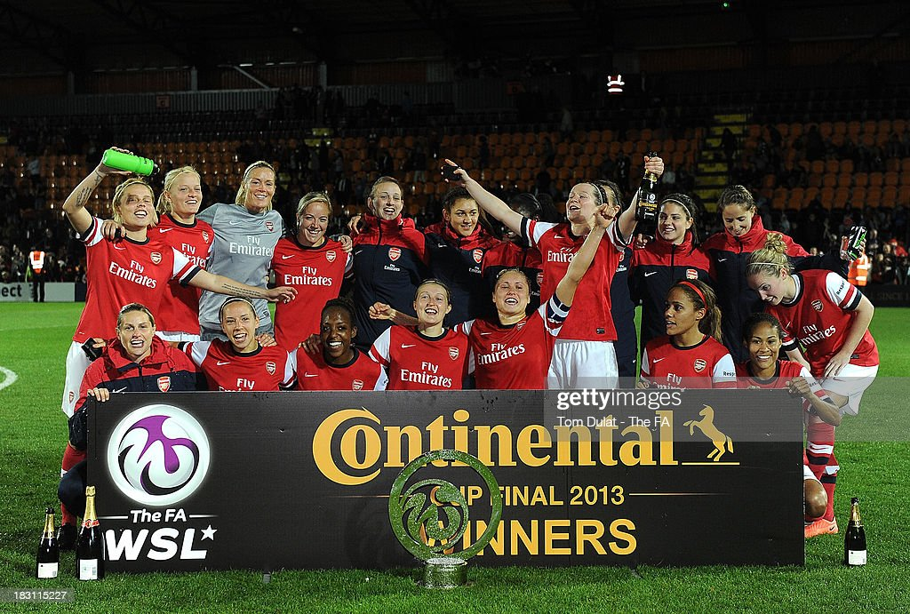 Arsenal team celebrate with the trophy after winning the The FA WSL Continental Cup Final match between Arsenal Ladies FC and Lincoln Ladies FC at...