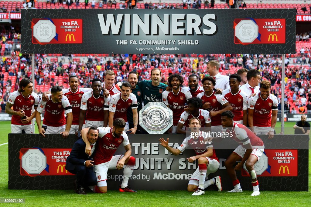 Arsenal team celebrate with the trophy following the The FA Community Shield final between Chelsea and Arsenal at Wembley Stadium on August 6, 2017 in London, England.