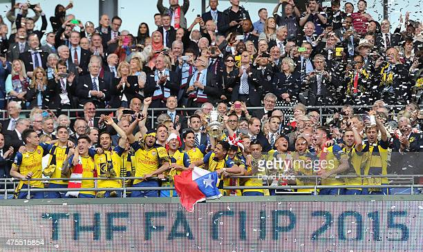 Arsenal team lift the trophy after the match between Arsenal and Aston Villa in the FA Cup Final at Wembley Stadium on May 30 2015 in London England