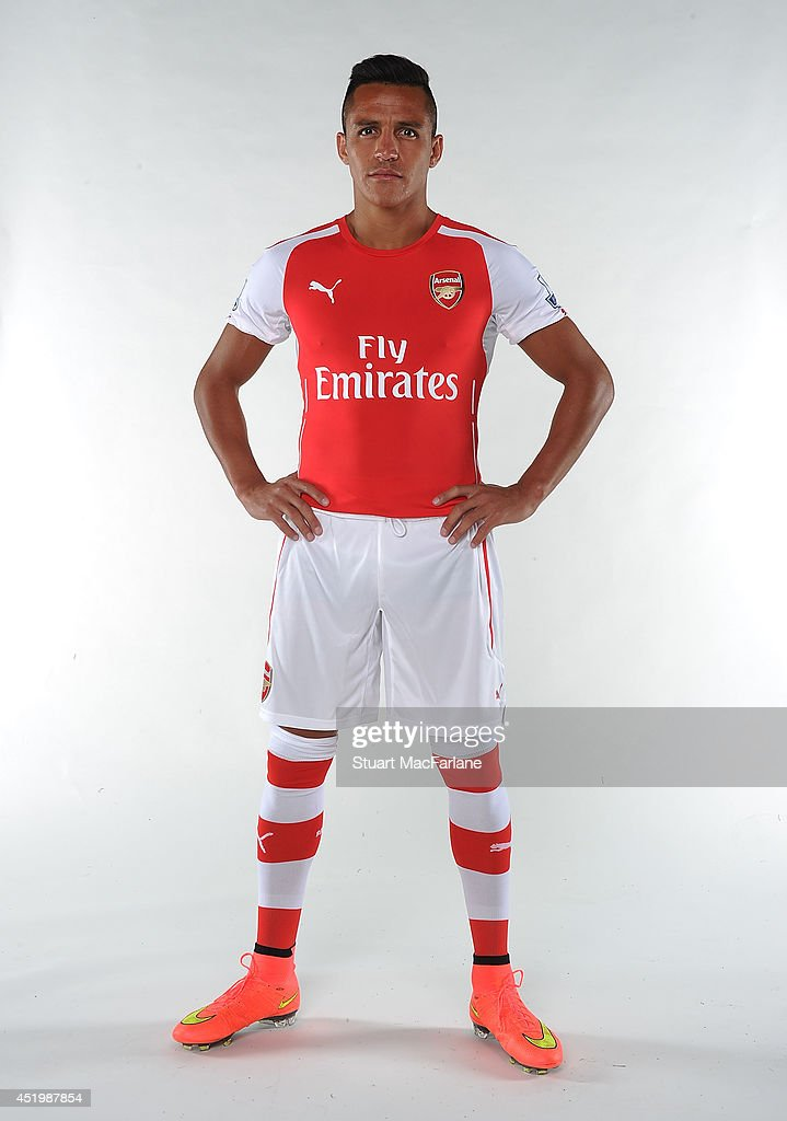 Arsenal unveil new signing <a gi-track='captionPersonalityLinkClicked' href=/galleries/search?phrase=Alexis+Sanchez&family=editorial&specificpeople=5515162 ng-click='$event.stopPropagation()'>Alexis Sanchez</a> at The Arsenal training ground, St Albans on July 10, 2014 in London, England.