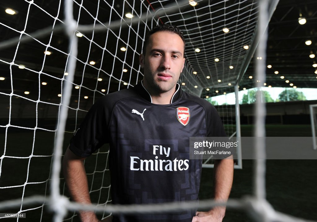 (MINIMUM PRINT/BROADCAST FEE OF GBP 150, ONLINE FEE OF GBP 75 PER IMAGE, OR LOCAL EQUIVALENT) Arsenal unveil new signing <a gi-track='captionPersonalityLinkClicked' href=/galleries/search?phrase=David+Ospina&family=editorial&specificpeople=4104267 ng-click='$event.stopPropagation()'>David Ospina</a> on July 28, 2014 in St Albans, England.