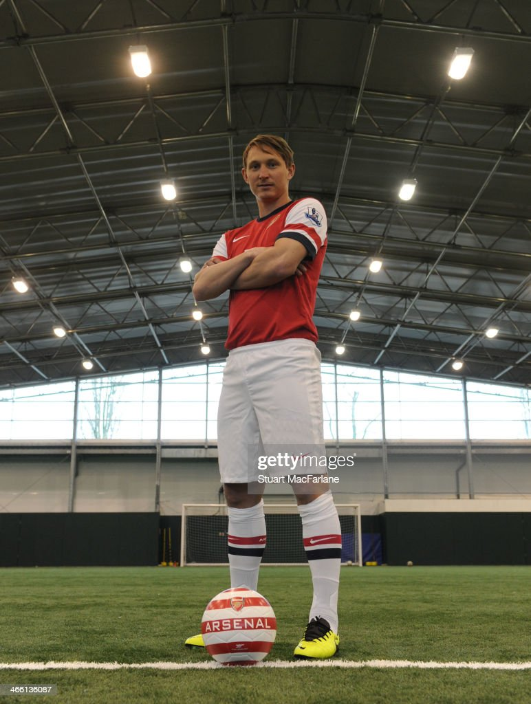 Arsenal unveil new signing <a gi-track='captionPersonalityLinkClicked' href=/galleries/search?phrase=Kim+Kallstrom&family=editorial&specificpeople=539780 ng-click='$event.stopPropagation()'>Kim Kallstrom</a> at London Colney on January 31, 2014 in St Albans, England.