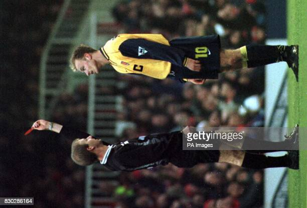 Arsenal were reduced to 10 men after 29 minutes when Bergkamp was sent off after appearing to go over the top during a tussle for the ball with...