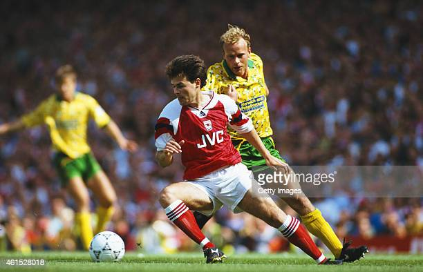 Arsenal wing Anders Limpar holds off the challenge of Jeremy Goss during a FA Premier League match between Arsenal and Norwich City at Higbury on...