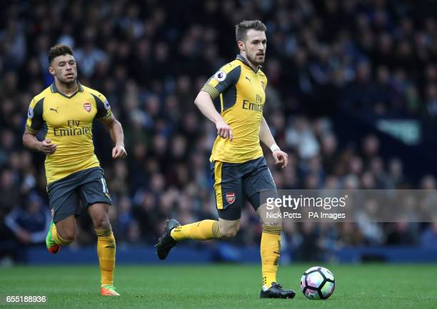 Arsenal's Aaron Ramsey and Alex OxladeChamberlain during the Premier League match at The Hawthorns West Bromwich