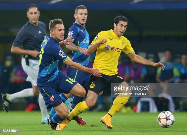 Arsenal's Aaron Ramsey and Borussia Dortmund's Henrikh Mkhitaryan battle for the ball