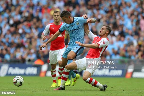 Arsenal's Aaron Ramsey and Manchester City's Stevan Jovetic battle for the ball during the Community Shield match at Wembley Stadium London