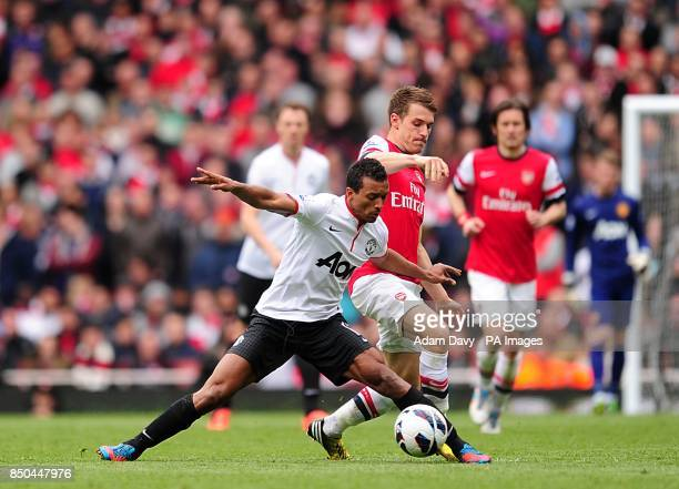 Arsenal's Aaron Ramsey and Manchester United's Luis Nani battle for the ball