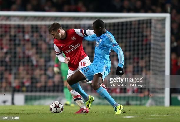 Arsenal's Aaron Ramsey and Marseille's Gilbert Imbula battle for the ball