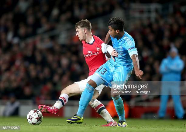 Arsenal's Aaron Ramsey and Marseille's Mario Lemina battle for the ball