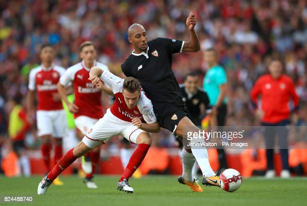 Arsenal's Aaron Ramsey and Sevilla's Steven N'Zonzi battle for the ball during the Emirates Cup match at the Emirates Stadium London