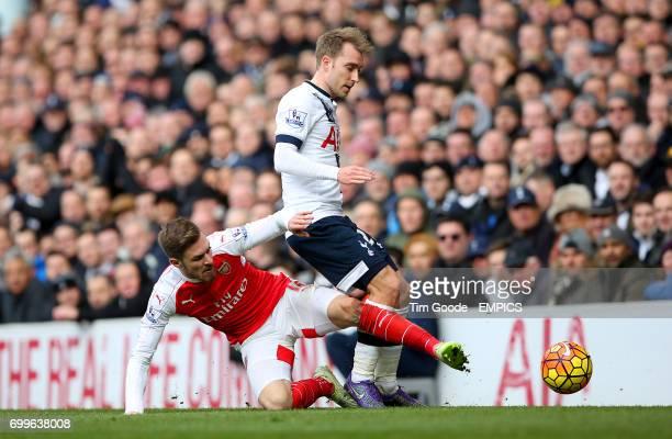 Arsenal's Aaron Ramsey and Tottenham Hotspur's Christian Eriksen battle for the ball