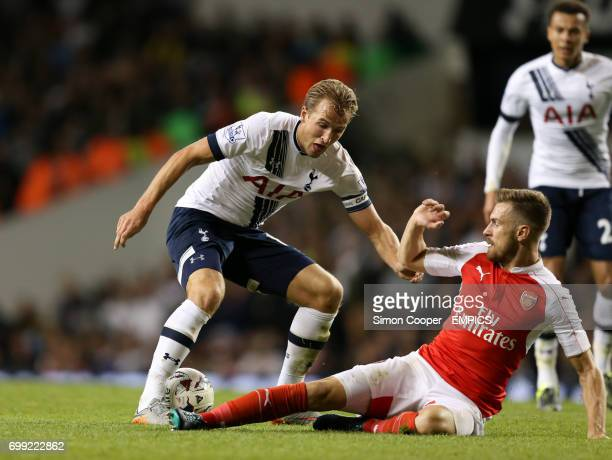 Arsenal's Aaron Ramsey and Tottenham Hotspur's Harry Kane battle for the ball