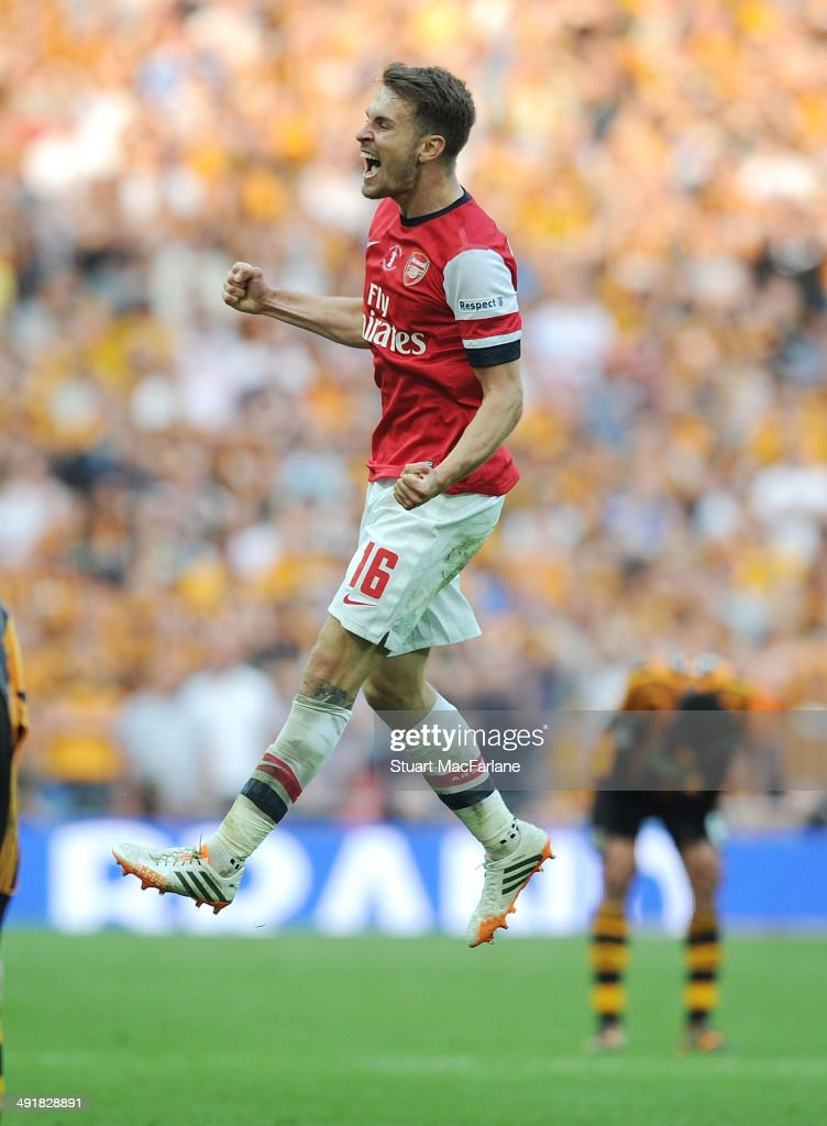 Arsenal's <a gi-track='captionPersonalityLinkClicked' href=/galleries/search?phrase=Aaron+Ramsey&family=editorial&specificpeople=4784114 ng-click='$event.stopPropagation()'>Aaron Ramsey</a> celebrates at the final whistle after the FA Cup Final between Arsenal and Hull City at Wembley Stadium on May 17, 2014 in London, England.