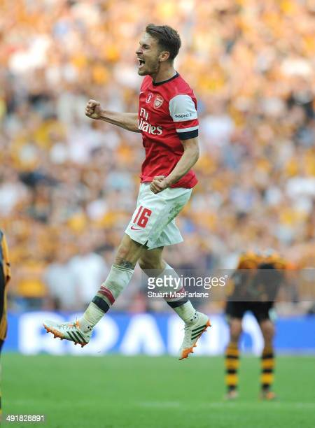 Arsenal's Aaron Ramsey celebrates at the final whistle after the FA Cup Final between Arsenal and Hull City at Wembley Stadium on May 17 2014 in...