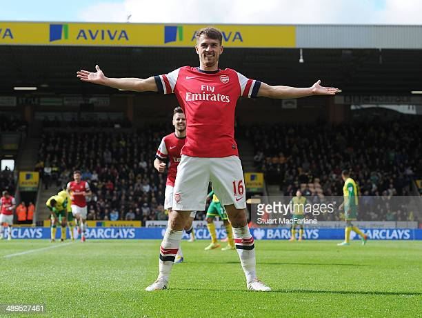 Arsenal's Aaron Ramsey celebrates his goal during the Barclays Premier League match between Norwich City and Arsenal at Carrow Road on May 11 2014 in...