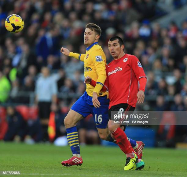 Arsenal's Aaron Ramsey is challenged by Cardiif City's Gary Medel during the Barclays Premier League match at Cardiff City Stadium Cardiff