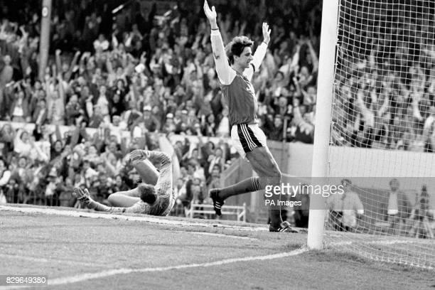 Arsenal's Alan Smith celebrates one of his team's five goals as beaten Norwich City goalkeeper Bryan Gunn lies in the box
