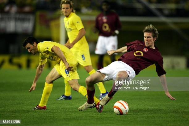 Arsenal's Aleksander Hleb is challenged by Villarreal's Juan Riquelme during the Champions League semifinal second leg match at Estadio El Madrigal...