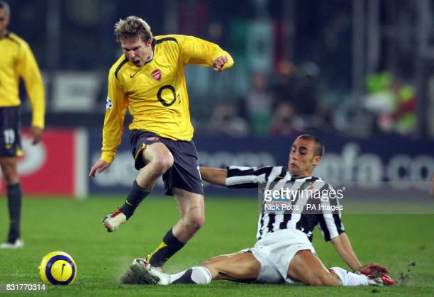 Arsenal's Aleksander Hleb is tackled by Juventus' Fabio Cannavaro during the UEFA Champions League quarterfinal secondleg match at the Stadio Delle...