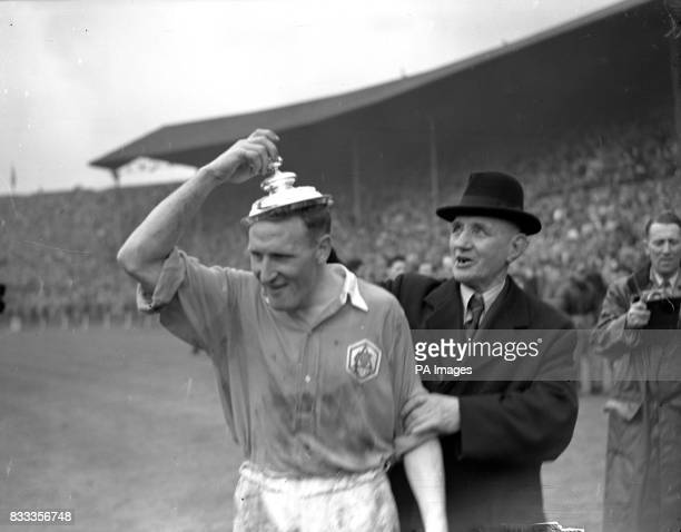 Arsenal's Alex Forbes tries on the FA Cup Trophy lid during the celebrations