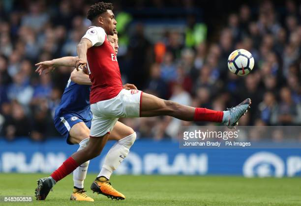 Arsenal's Alex Iwobi and Chelsea's Gary Cahill battle for the ball during the Premier League match at Stamford Bridge London