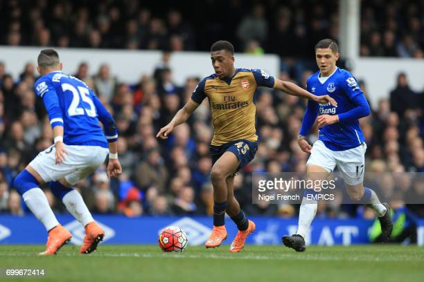 Arsenal's Alex Iwobi and Everton's Muhamed Besic battle for the ball