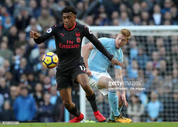 Arsenal's Alex Iwobi and Manchester City's Kevin De Bruyne battle for the ballb during the Premier League match at the Etihad Stadium Manchester