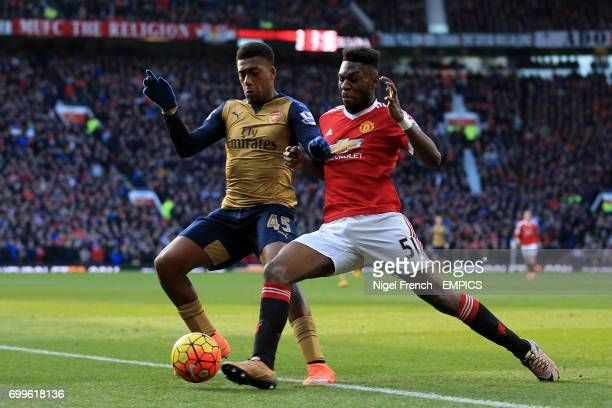 Arsenal's Alex Iwobi and Manchester United's Timothy FosuMensah battle for the ball