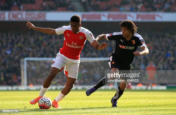 Arsenal's Alex Iwobi and Watford's Nathan Ake battle for the ball