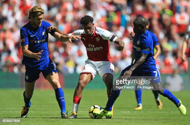 Arsenal's Alex Iwobi battles with Chelsea's Marcos Alonso and Chelsea's Ngolo Kante during the Community Shield at Wembley London
