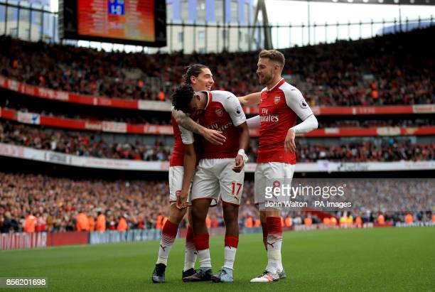 Arsenal's Alex Iwobi celebrates scoring his side's second goal of the game with teammates Aaron Ramsey and Hector Bellerin during the Premier League...