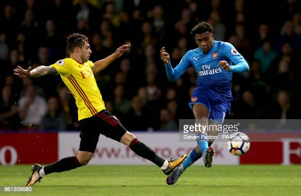 Arsenal's Alex Iwobi has a shot on goal during the Premier League match at Vicarage Road Watford