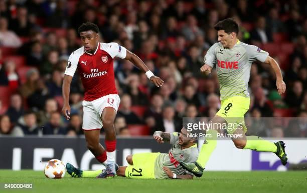 Arsenal's Alex Iwobi leaves behind FC Koln's Leonardo Bittencourt and Milos Jojic