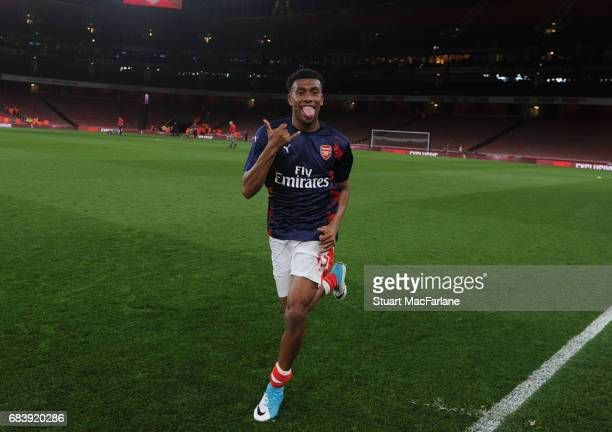 Arsenal's Alex Iwobi trains on the pitch after the Premier League match between Arsenal and Sunderland at Emirates Stadium on May 16 2017 in London...