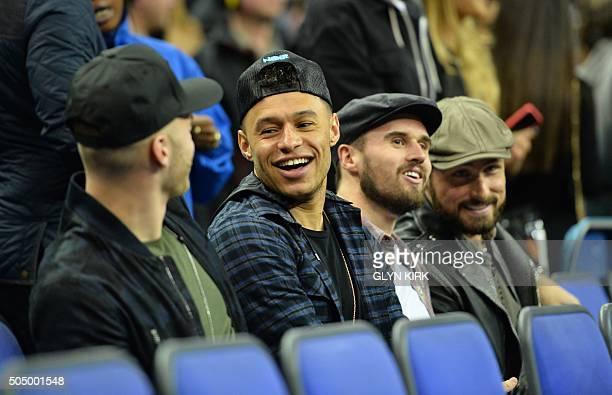 Arsenal's Alex Oxlade Chamberlain Carl Jenkinson and French forward Olivier Giroud watch the NBA Global Game London 2016 basketball match between...