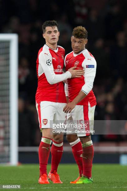 Arsenal's Alex OxladeChamberlain and Arsenal's Granit Xhaka look dejected at full time of the UEFA Champions League Round of 16 second leg match...