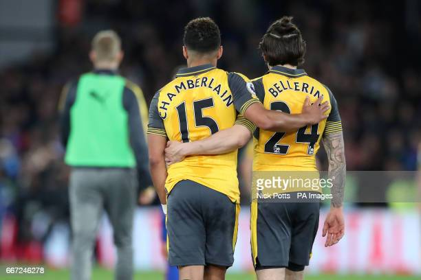 Arsenal's Alex OxladeChamberlain and Arsenal's Hector Bellerin leave the pitch dejected after the final whistle