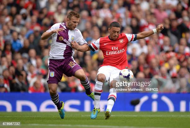 Arsenal's Alex OxladeChamberlain and Aston Villa's Andreas Weimann battle for the ball
