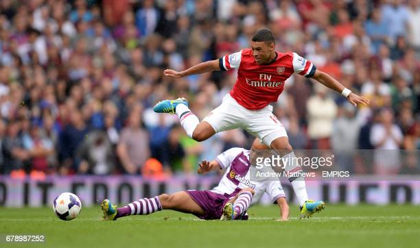 Arsenal's Alex OxladeChamberlain and Aston Villa's Karim El Ahmadi battle for the ball