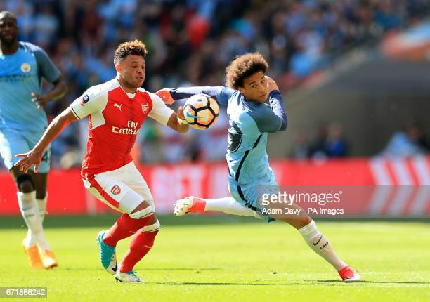 Arsenal's Alex OxladeChamberlain and Manchester City's Leroy Sane battle for the ball during the Emirates FA Cup Semi Final match at Wembley Stadium...