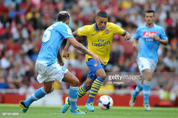 Arsenal's Alex OxladeChamberlain and Napoli's Valon Behrami battle for the ball