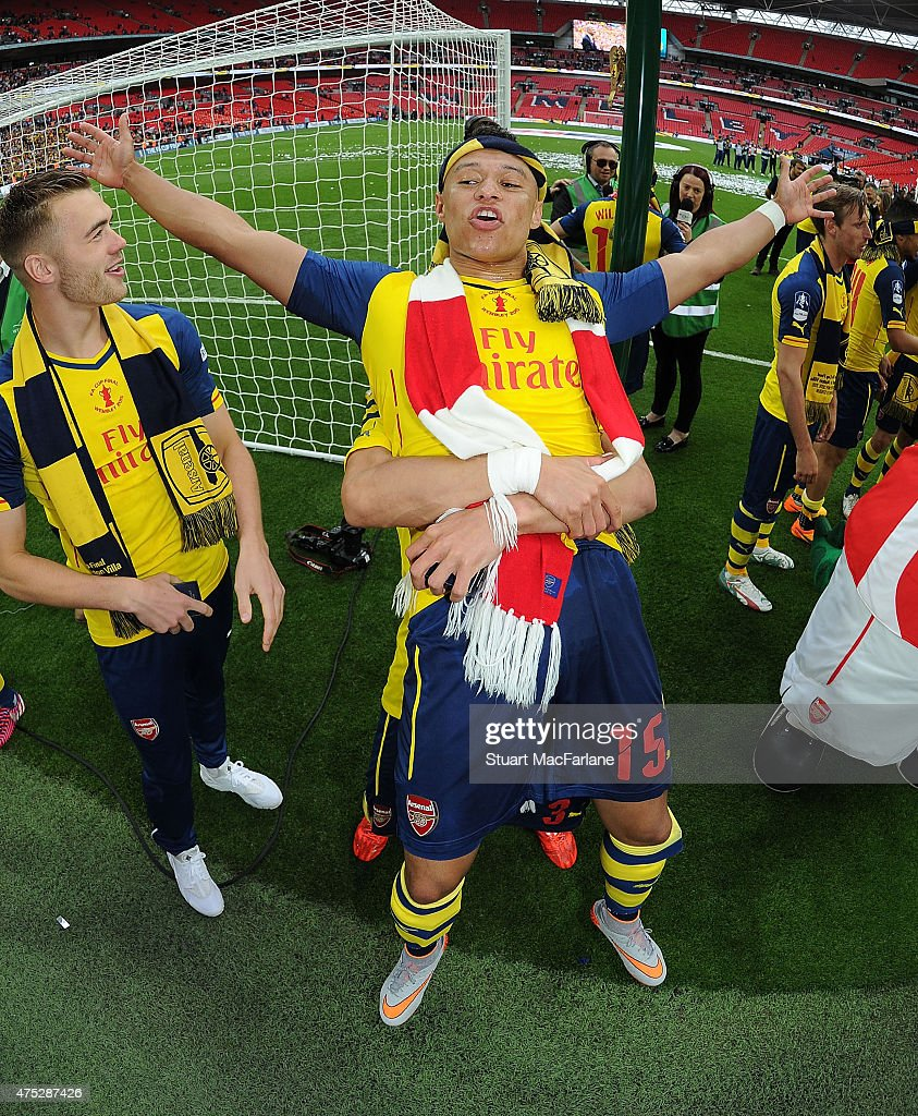 Arsenal's <a gi-track='captionPersonalityLinkClicked' href=/galleries/search?phrase=Alex+Oxlade-Chamberlain&family=editorial&specificpeople=7191518 ng-click='$event.stopPropagation()'>Alex Oxlade-Chamberlain</a> celebrates after the FA Cup Final between Aston Villa and Arsenal at Wembley Stadium on May 30, 2015 in London, England.