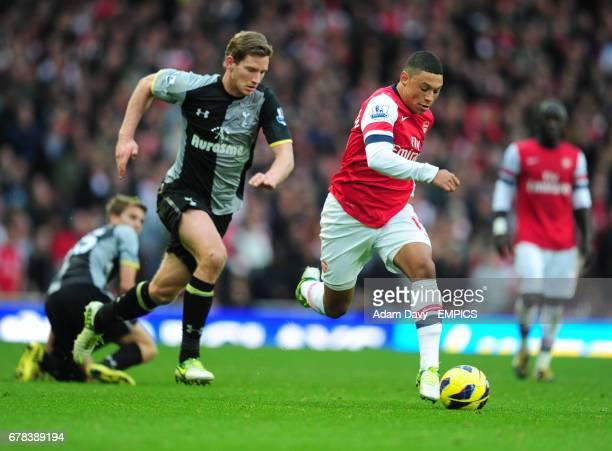 Arsenal's Alex OxladeChamberlain gets away from Tottenham Hotspur's Jan Vertonghen