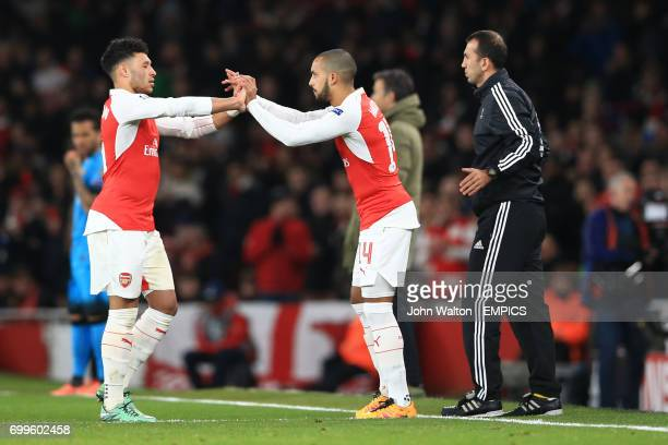 Arsenal's Alex OxladeChamberlain substituted for team mate Theo Walcott