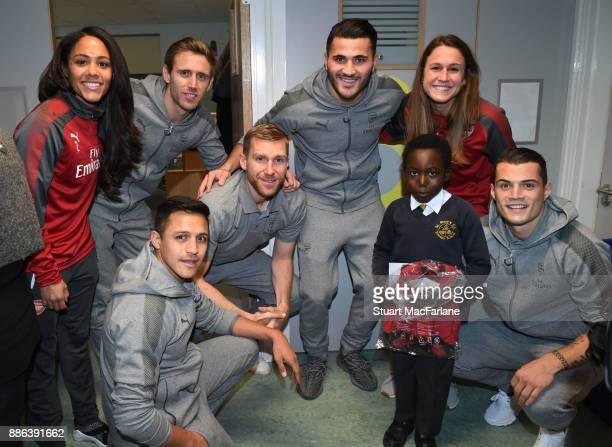 Arsenal's Alex Scott Nacho Monreal Alexis Sanchez Per Mertesacker Sead Kolasinac Heather O'Reilly and Granit Xhaka visit the Whittington Hospital on...