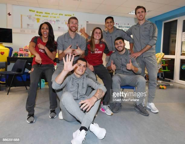 Arsenal's Alex Scott Per Mertesacker Granit Xhaka Heather O'Reilly Alexis Sanchez Sead Kolasinac and Nacho Monreal visit the Whittington Hospital on...