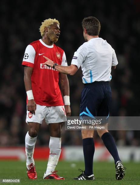 Arsenal's Alex Song argues with referee Nicola Rizzoli