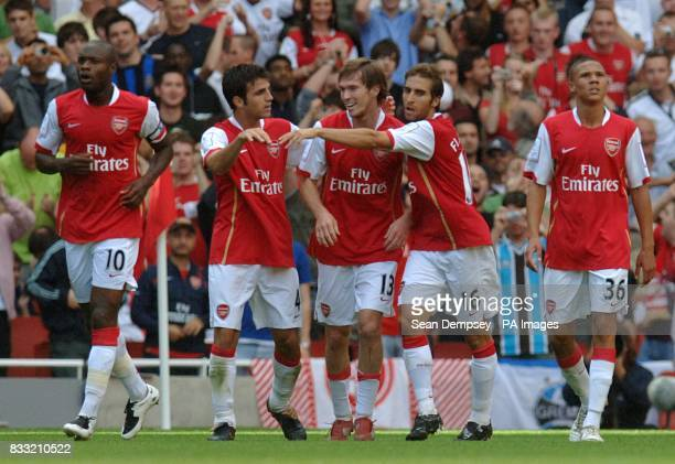 Arsenal's Alexander Hleb celebrates scoring the second goal of the game with team mates Francesc Fabregas and Mathieu Flamini