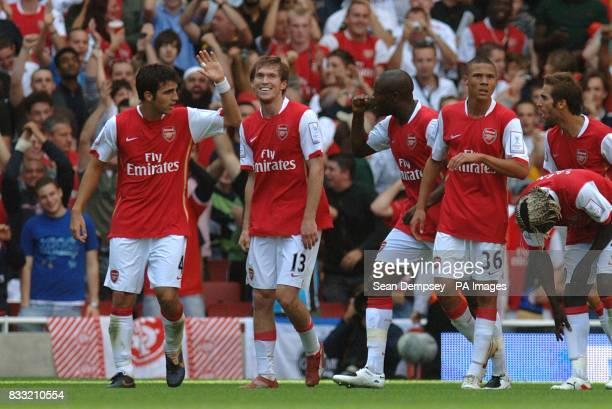 Arsenal's Alexander Hleb celebrates scoring the second goal of the game with team mates Francesc Fabregas and William Gallas